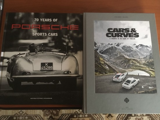 Assorted Porsche Motorsport hardback volumes.
