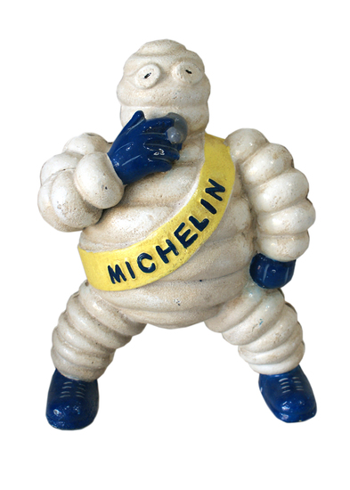 Michelin Man Smoking' figure.