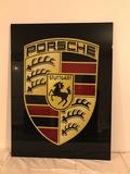 'Porsche' logo wall sign.