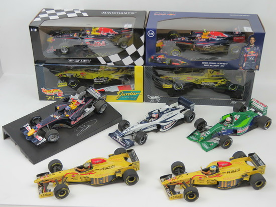 Nine 1:18 scale racing cars