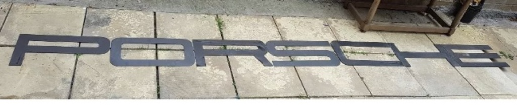 A very large font-correct 'Porsche' hanging wall sign