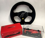 Racing steering wheel, signed by Kimi Raikkonen