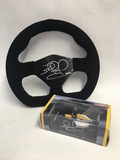 Racing steering wheel, signed by Nigel Mansell CBE