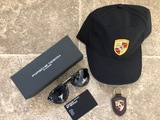 Porsche branded baseball cap, sunglasses and key fob
