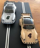 A pair of iconic 1970s Porsche 935 Scalextric cars