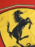 Ferrari flag, signed by Kimi Raikkonen & Nigel Mansell CBE