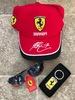 Ferrari branded baseball cap, sunglasses and key fob