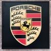 Illuminated Porsche shield wall sign