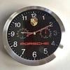Fine circular Porsche wall clock