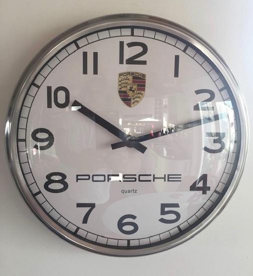 A fine circular Porsche-themed wall clock