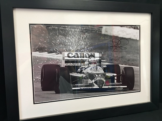 Williams FW11 photograph, signed by Nigel Mansell CBE