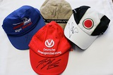 Four F1 driver-signed F1 caps