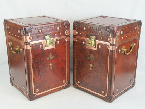 A fine pair of leather and copper Army and Navy style trunks