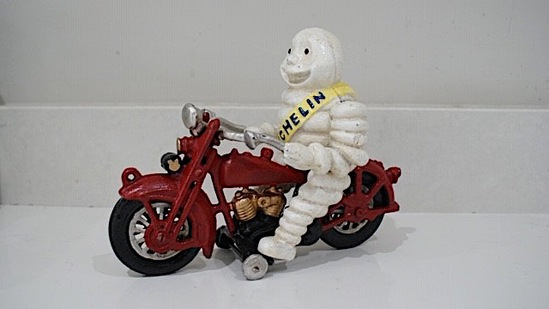 Mr Bibendum Michelin figurine on motorcycle