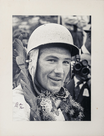Signed and mounted photograph of Sir Stirling Moss 2/200