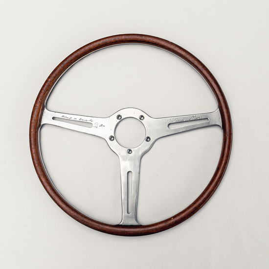 A  race used period steering wheel hand signed by Stirling Moss