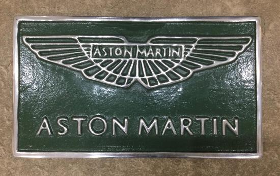 A Cast Metal Aston Martin Themed Sign with AM Wings Over