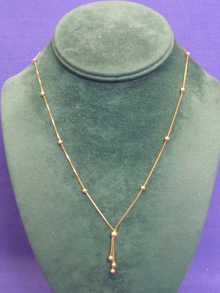 "14 Kt Gold Necklace – 17"" long with a 1"" drop – Weight is 2.7 grams"
