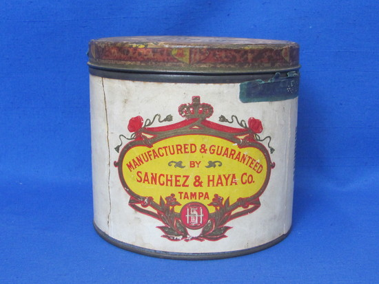 """Round Cigar Tin with Paper Label """"Sanchez & Haya Co. Tampa, Fla.""""  4 3/4"""" tall – 5 1/4"""" in diameter"""