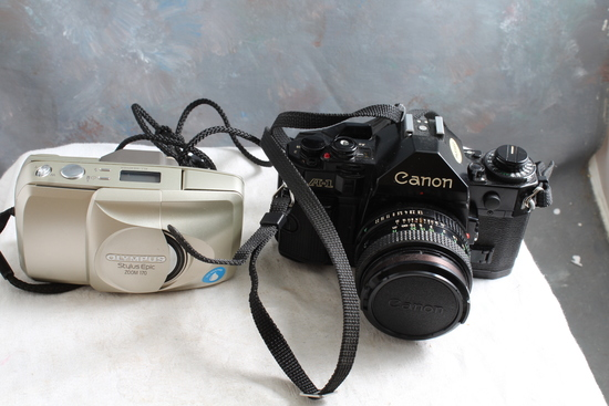 2 Vintage Cameras CANON A-1 SLR with 50mm Canon Lens & Olympus Stylus
