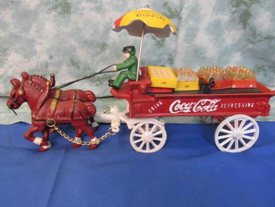 Cast Iron Coca Cola Wagon – 2 Horse team, 1 Driver, 1 Dog, 5 cases, 1 dolly, 1 Umbrella