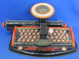 "Tin Litho Junior Dial Typewriter by Marx – Black & Red – About 10 3/4"" wide"