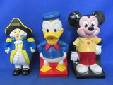 "3 Vintage Plastic Banks – 2 Disney (7 1/2"" T) & Soft Plastic Admiral (7""T)"