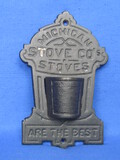 "Cast Iron Match Holder ""Michigan Stove Co's Stoves are the Best"" - 7"" long"