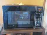 """Whirlpool Microwave 24 1/2"""" x 16 1/4"""" x 14 ½"""" T – functioning but older"""