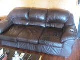 Brown Leather Couch 7 Ft Long – One seat cushion has been taped