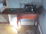 Electric Singer Sewing Machine w/wood cabinet, Queen Anne Legs w/original manual