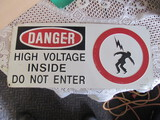 """Embossed Danger High Voltage Sign 18 1/2"""" Long x 8 1/2"""" W – good condition"""