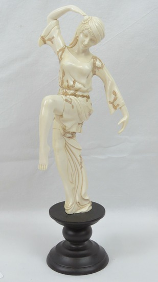 A delightful carved and polished Woolly Mammoth tusk segment in the form of a European dancing lady