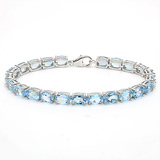22.25 CT SKY BLUE TOPAZ 925 STERLING SILVER TENNIS BRACELET IN OVAL SHAPE