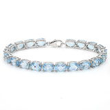 22.45 CT SKY BLUE TOPAZ 925 STERLING SILVER TENNIS BRACELET IN OVAL SHAPE