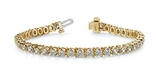 14K YELLOW GOLD .75 CTW G-H I1/I2 PRONG SET DIAMOND STRAND TENNIS BRACELET