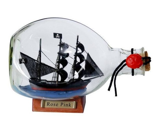 Ed Lows Rose Pink Pirate Ship in a Glass Bottle 7in.