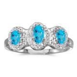 10k White Gold Oval Blue Topaz And Diamond Three Stone Ring 0.58 CTW