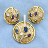 Designer Diamond, Sapphire, And Ruby Statement Pendant And Earring Set In 14k Yellow And White Gold