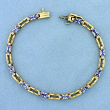 3ct Tw Natural Tanzanite And Diamond Bracelet In 14k Yellow Gold
