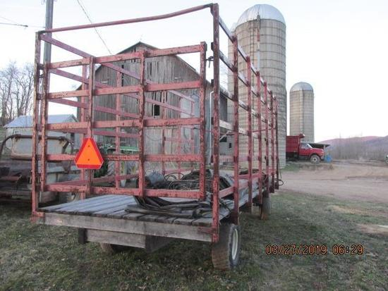 Flat bed hay wagon with metal racks