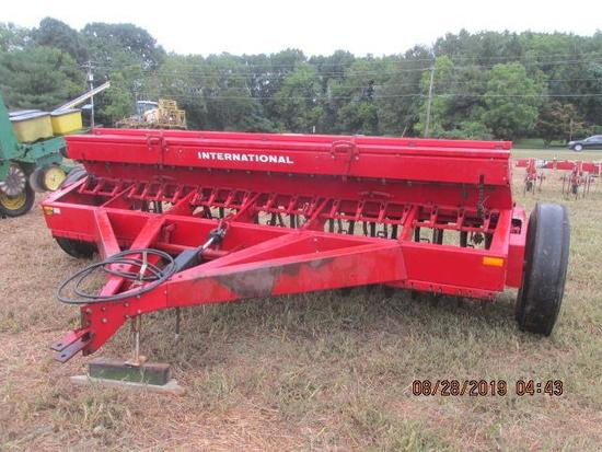 "IH # 5100 seed drill with grass boxes, 21 hole X 7"" spacing"