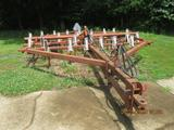 Wilrich Field cultivator, trailer type with short C shank type teeth and Krause buster bar