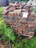 Skid of red bricks
