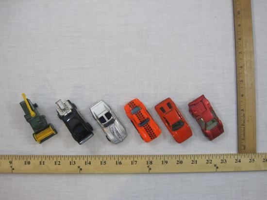 Six Assorted Matchbox Cars from 1970s-1990s including 1977 Harvester and more, 9 oz
