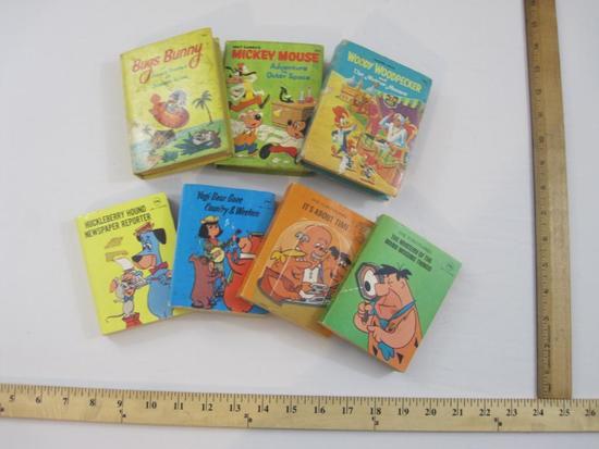 Seven Vintage Children's Books including Flintstones, Yogi Bear, Bug Bunny, Mickey Mouse and more,