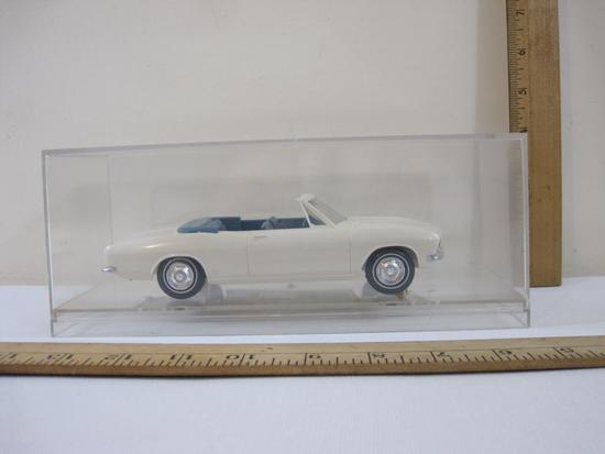 1965 White Chevrolet Corvair Promo Model Car, 2-Door Convertible with blue interior, in plastic