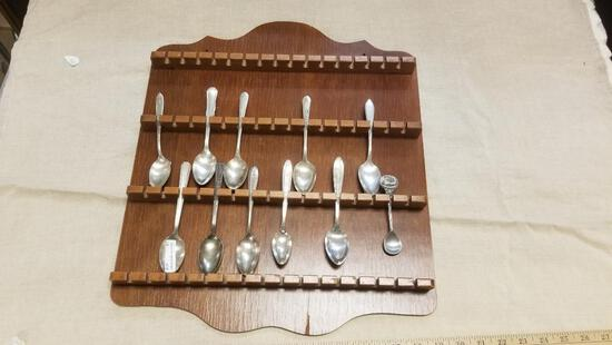 Wooden Display Rack, complete with 11 Spoons, Some Silver plate