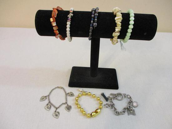 "8 Bracelets including beaded, hearts with ""Donna"" and more, 5 oz"