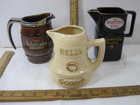 Three Decorative Scotch Pitchers, Ambassador Deluxe, Bells, Martins VVO, 2 have hairline crack, see